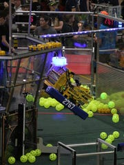 The robot for the Stryke Force robotics team from the Kalamazoo area climbs during the world championships April 29 in St. Louis.