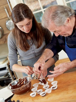 Jacques Pepin and granddaughter Shorey, 13, make chocolate treats together.