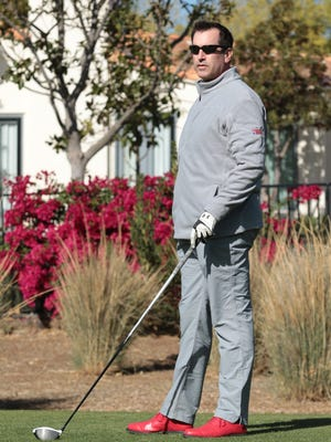 Rob Riggle gets ready to hit a shot during Monday's Rob Riggle InVETational at the North Ranch Country Club. The event raised money for the Semper Fi Foundation.