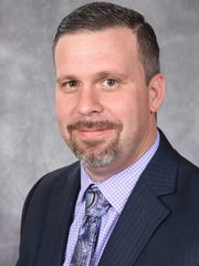 Luke Hall is an arts educator and Treasure Coast High School band director.