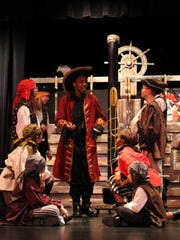 """Captain Hook (center, played by Julien Johnson) speaks to his fellow pirates during rehearsal of Brown Deer's """"Peter Pan."""""""