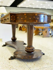 A nearly 200 year old table is part of a silent auction
