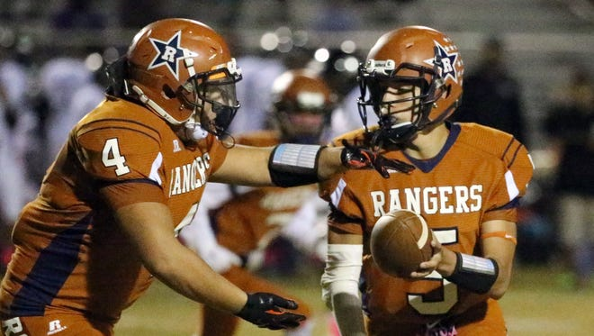 Riverside running back Alonso Borja, 4, gets the hand-off from quarterback Aaron Samaniego Friday night against Hanks.