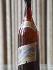 A Thieme & Wagner's Bohemian beer bottle that is part of Walt Griffin's Thieme & Wagner collection. Griffin said the bottle is probably dates to around 1910. Griffin added that it is extremely rare to have both labels still on the bottle.