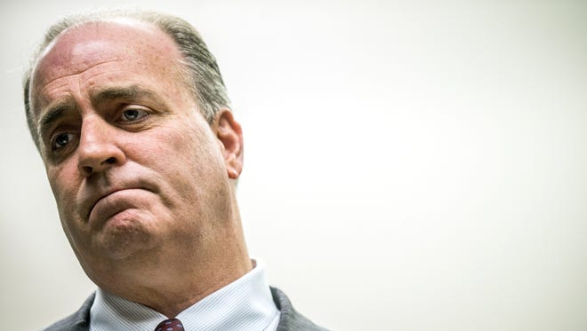 U.S. Rep. Dan Kildee, D-Flint Township, takes a moment before reading through a message from Amir Hekmati's family during a press conference on Sunday, Jan. 17, 2016 at his office in Flint, Mich. Hekmati, a U.S. Marine and Flint Central High School graduate, is one of five American prisoners being released from Iran. He was taken prisoner August 2011. Kildee will travel to Germany Sunday with members of Hekmati's family to see him for the first time in more than four years. (Jake May/The Flint Journal-MLive.com via AP)