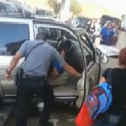 Police arrest the man after ramming an SUV in to the side of the gas station twice.