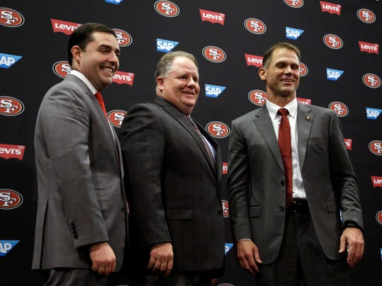 FILE- In this Jan. 20, 2016, file photo, from left, San Francisco 49ers CEO Jed York, head coach Chip Kelly, and General Manager Trent Baalke pose for a photo after a media conference in Santa Clara, Calif. The San Francisco 49ers have fallen to a new level of failure and futility, a laughingstock of the league. Among the worst they've ever been when all that winning of just a few years back is still so fresh. After an impressive shutout of the Rams in the season opener that lifted spirits for a turnaround following two straight seasons out of the playoffs, San Francisco has lost a franchise-worst 10 straight games since then. (AP Photo/Ben Margot, File)
