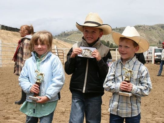 Past Junior Rodeo participants show off their buckles and trophies.