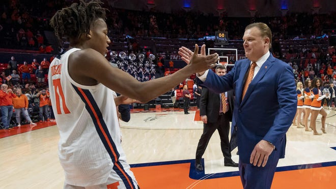 llinois guard Ayo Dosunmu, shown with coach Brad Underwood, is a unanimous first-team All-Big Ten pick.