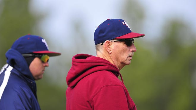 Head coach Kenny Thomas (right) watches the players during USC Aiken's baseball practice on Saturday, Jan. 26, 2014.