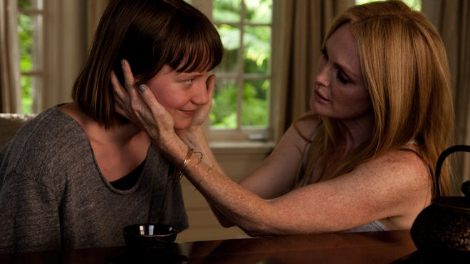 """Julianne Moore (right) and Mia Wasikowska appear in a scene from """"Maps to the Stars."""""""