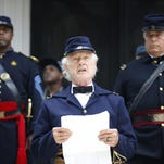 Brian Bibeau plays the role of Brigadier Gen. Edward McCook as he recites the Emancipation Proclamation Wednesday on the steps of the Knott House Museum. The program was a part of the Emancipation Day Celebration.