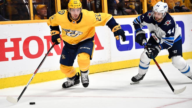 Predators left wing Kevin Fiala (22) moves the puck defended by Jets defenseman Josh Morrissey (44) during the third period in game 1 of the second round NHL Stanley Cup Playoffs at the Bridgestone Arena Friday, April 27, 2018, in Nashville, Tenn.