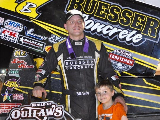"Bill Balog of Hartland poses with his older son Dylan, 5, after winning the 2016 edition of the World of Outlaws Jim ""JB"" Boyd Memorial race  at Beaver Dam."