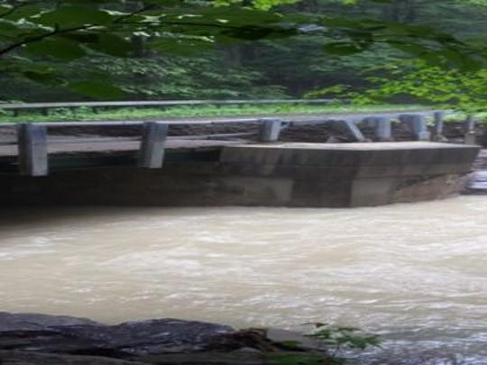 An abutment on Carter Creek Road Bridge separated from the roadway during the June 14 flood.