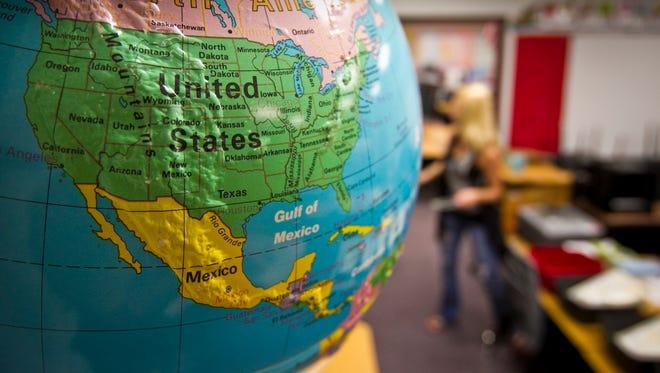 The judge in Arizona's battle over school funding has called for settlement talks.