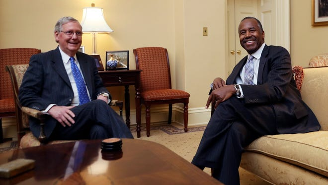 Senate Majority Leader Mitch McConnell, left, of Kentucky meets with HUD Secretary nominee Ben Carson on Capitol Hill in Washington, Wednesday, Dec. 7, 2016.