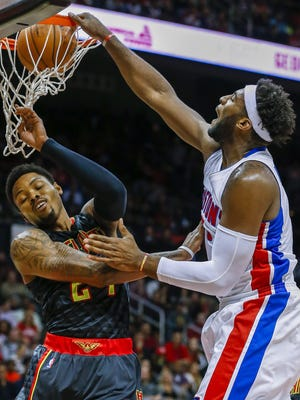 Detroit Pistons center Andre Drummond dunks the ball against Atlanta Hawks guard Kent Bazemore during the first half of the NBA basketball game between the Detroit Pistons and the Atlanta Hawks, at Philips Arena in Atlanta, Georgia, USA, 27 October 2015.
