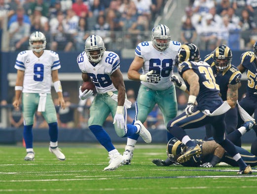 """[NFC grades by Jim Corbett] Cowboy (C): Who are these guys? Coach Jason Garrett was stripped of his play-calling duties and offensive line coach Bill Callahan was supposed to run his offense through RB DeMarco Murray (29). But with the exception of Murray's 176-yard game against the Rams, the Cowboys are still built around QB Tony Romo, which means riding the up-and-down """"Romocoaster.''"""