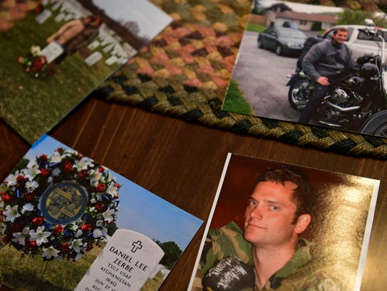 Photos of Technical Sgt. Dan Zerbe sit on a table in