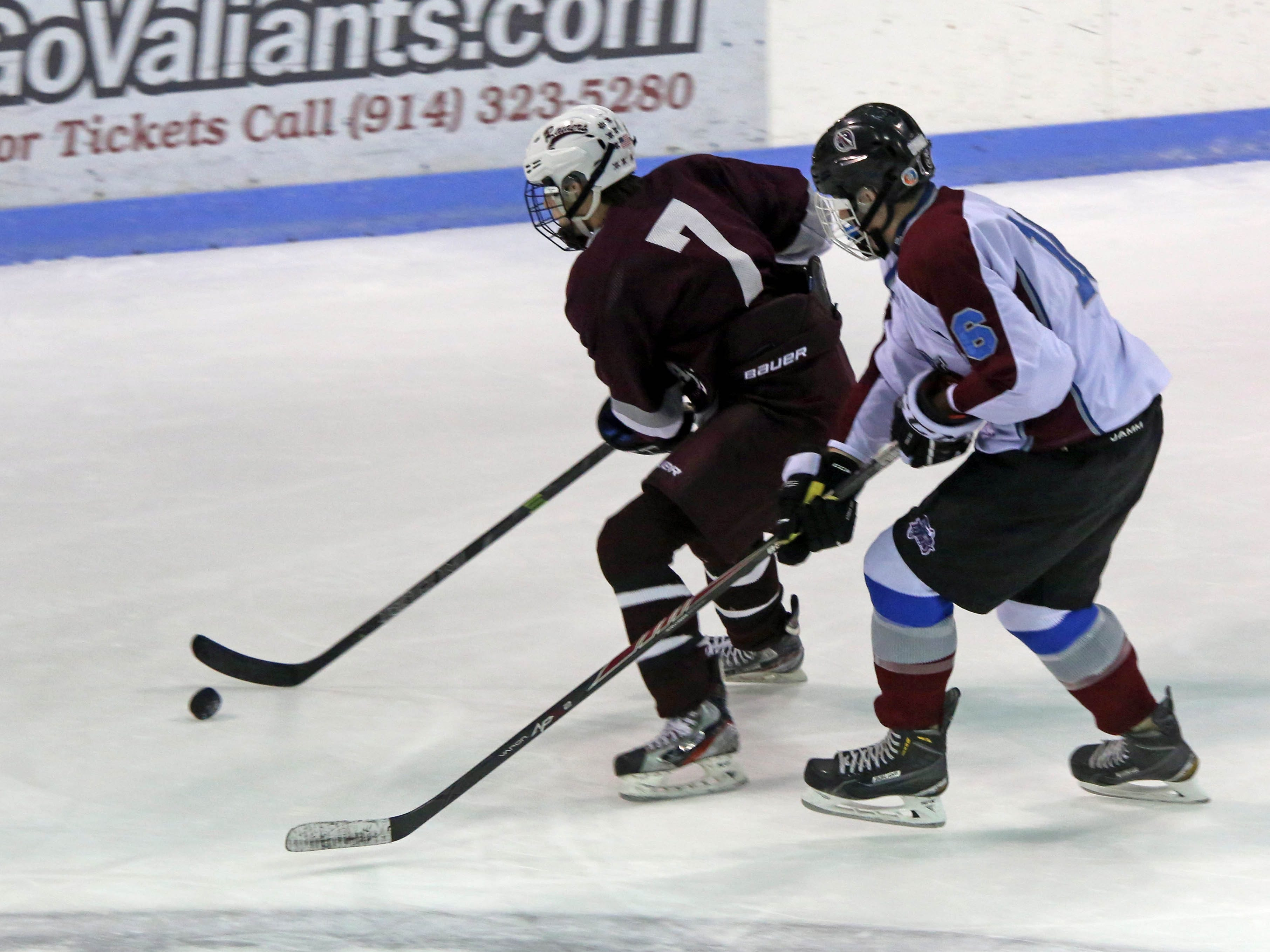 Scarsdale's Brandon Bank (7) gains control of the puck over Rye Town/Harrison's William Pizzutello (6) during boys hockey at Rye Playland on Jan. 12, 2015.