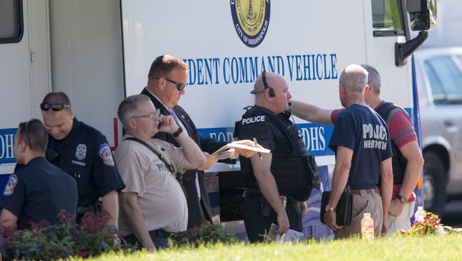 Indianapolis Metropolitan Police Department responds to a morning call of a suicidal person in a condominium complex in the 6200 block of Amber Creek Lane on Sept.  9, 2014.