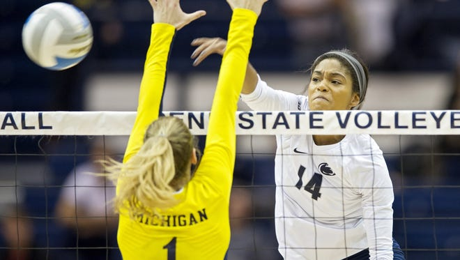 Michigan volleyball player Claire Kieffer-Wright goes for a block Nov. 18, 2015, in University Park, Pa. Michigan won, 3-1.