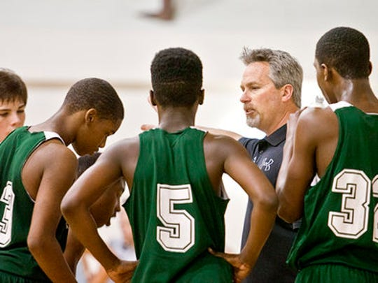 Director of Sports Ministry Dwayne Sanders works with Emerald Youth basketball players.