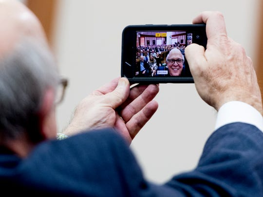 U.S. Magistrate Judge Clifford Shirley takes a selfie during the retirement celebration at the US District Court in Knoxville, Tennessee on Friday, February 9, 2018. Shirley served as magistrate judge in Knoxville for over 16 years.