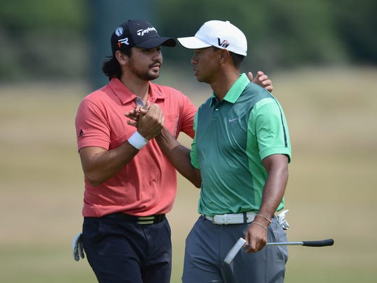 Tiger Woods, right, and  Jason Day play a practice