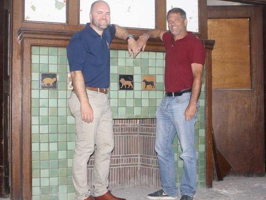 Plymouth mayor Oliver Wolcott (left) and Curtis Building's Mark Menuck admire Starkweather's 90-year-old fireplace.