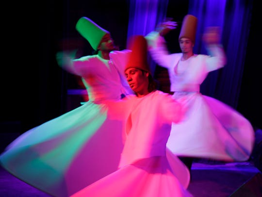 "Egyptians dance in traditional costumes as they perform Sufi dance known as ""whirling dervish"" in Cairo, Egypt in 2015."