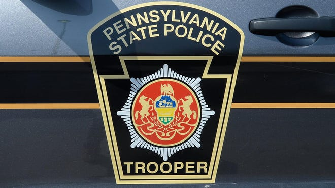 A Pennsylvania State Police SUV is parked outside the Troop E headquarters on May 2, 2020, in Lawrence Park Township.