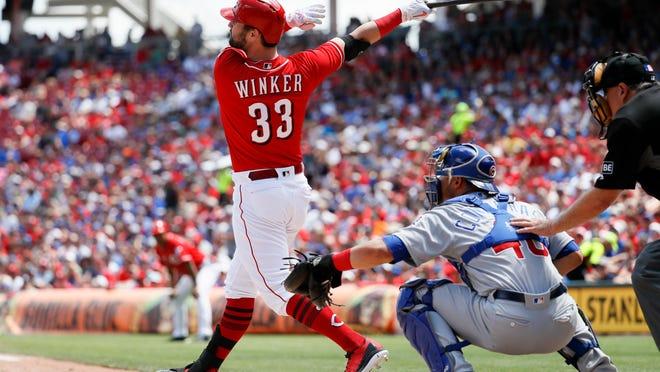 Cincinnati Reds' Jesse Winker hits a three-run home run off Chicago Cubs relief pitcher Pedro Strop in the seventh inning of a baseball game, Sunday, June 24, 2018, in Cincinnati. (AP Photo/John Minchillo)