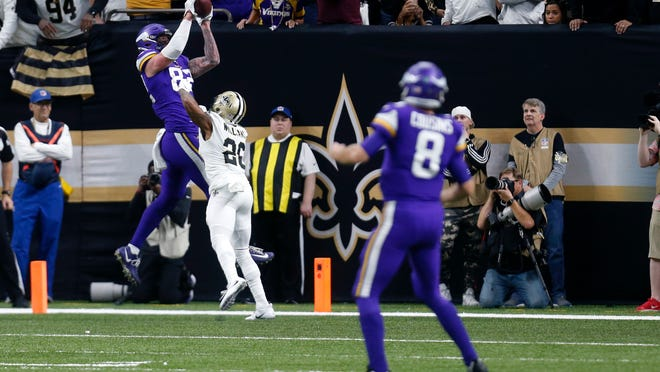 Minnesota Vikings tight end Kyle Rudolph (82) pulls in the game winning touchdown pass over New Orleans Saints cornerback P.J. Williams (28) during overtime of an NFL wild-card playoff football game, Sunday, Jan. 5, 2020, in New Orleans. The Vikings won 26-20. (AP Photo/Butch Dill)