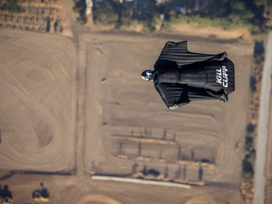 Andy Stumpf jumping in a wing suit over Davis, Calif.