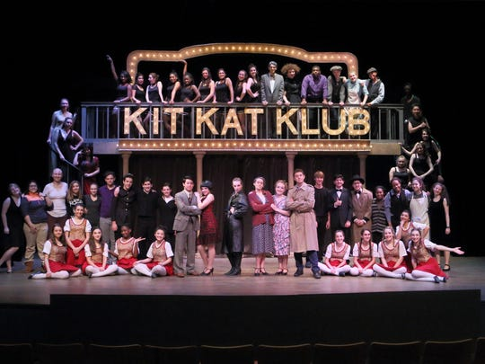 "Pingry's Drama and Music Departments presented Kander and Ebb's ""Cabaret"" at the school in Bernards from Feb. 25-27. First row, kneeling: Mary Kovacs of Lebanon, Lydia Gargano of Westfield, Hannah Guglin of Basking Ridge, Rashida Mohammed of Bedminster, Kristine Fu of Whippany, Alessia Zanobini of New Vernon, Ally Lima of Summit, Dorothea Miller of Madison, Kat Deliargyris of Basking Ridge, and Isabel DeVito of South Plainfield.  Second row, standing: Saxon Scott of Far Hills, Katherine Trejo of Newark, Hanna Davis of Summit, Sidney Shannon of Warren, Abigail Berger of Hillsborough, Thomas Campbell of Hillside, Lucas Vazquez of Millington, Nick Grimaldi of Scotch Plains, Andrew Cowen of New Vernon, Justin Wang of Warren, Erin Dugan of Westfield, Olivia Sartorius of Summit, Jazmin Palmer of Lebanon, Katharine Matthias of Basking Ridge, Connor Beard of Warren, Jason Bisgay of Fanwood, Rajeev Doraswamy of Short Hills, Jackson Lubke of South Orange, Lauryn Rodney of Somerset, Udochi Emeghara of Hillside, Allie Matthias of Basking Ridge, and Tracy Cooper of Morristown.  Stairs left, going up: Megan Pan of Short Hills, Kayla Thau of Bound Brook, and Meghan Salamon of Long Valley. Stairs right, going up: Ursula Dedekind of Millburn, Jessie McLaughlin of Maplewood, Aidan Zola of Washington, TanTan Wang of Warren, and Calvary Dominique of West Orange. Top row, standing: Taylor Dupree of Somerset, Sonali Mehta of Montville, Isabella Zanobini of New Vernon, Taraja Arnold of Newark, Raena LeBourne of Maplewood, Danielle LeGrand of High Bridge, Hannah Benton of Randolph, Caroline Terens of Scotch Plains, EmmaClaire Marvin of Summit, Brian Grimaldi of Scotch Plains, Liz Cooper of Morristown, Jackson Artis of Plainfield, Sara Donovan of Summit, Alison Verdesca of Mendham, and Jewell Strickland of Newark."