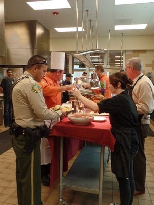 Culinary arts students at La Quinta High School serve a Thanksgiving meal they prepared for valley public safety officials and personnel.