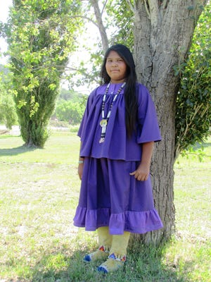 Trishelle  Matcher marks her rite of passage at the Mescalero Ceremonial Grounds over the holiday