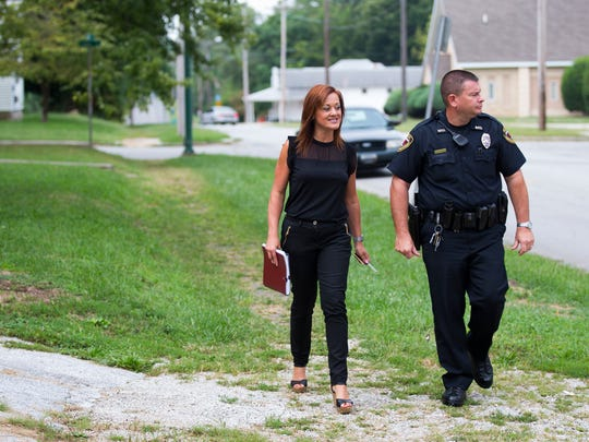 Community Mental Health Liaison Melissa Daugherty and Springfield Police Officer Matt Lilly walk to a woman house to perform a home mental health checkup on Thursday, Sept. 1, 2016.