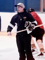 Essex boys hockey coach Bill O'Neil runs drills during practice during this photo from 1999.