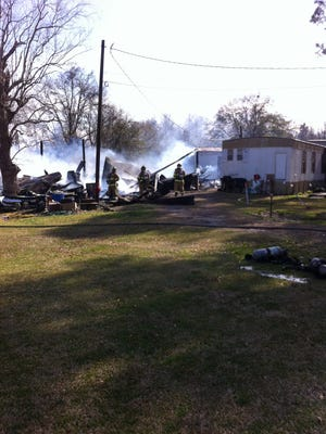 Firefighters are on the scene of a large shed fire on Johnston Street.