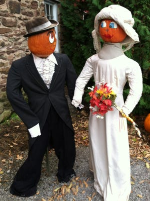 Two of the approximately 80 pumpkin people that decorate Cobble Creek Farm in Spencerport.