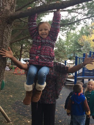 Elianna Carter from Room 3 at All Kids First enjoys hanging around the school yard with a little help from teacher Lisa Griffin!