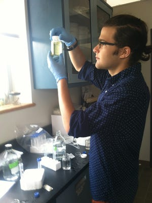 A student conducts research at the Center for the Urban River at Beczak.