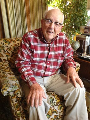 Johnson Stearns (1917-2015), last surviving charter member of Carrizozo Rotary, is shown seated in his living room last year reminiscing of days gone by.