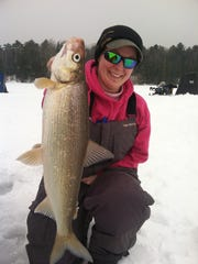 Lacey Kastern with a big whitefish caught on Chequamegon