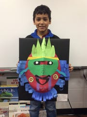 """Isaac Rosales shows off his Paper Mask, """"The Costume Puppet."""""""