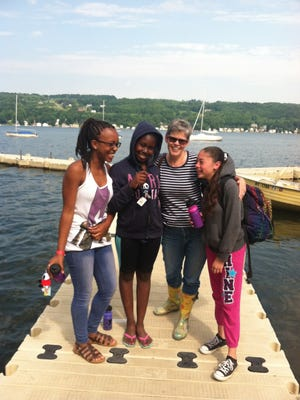 Shamonnie Lee, left, Samari Brown, Jeanne Strazzabosco and  Daniellisse Santos on a dock at Camp Cory on Keuka Lake.