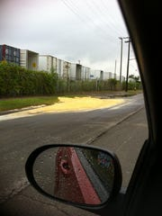 A yellowish foam spreads on the street and median near the US Ecology hazardous waste facility on Georgia Street in this Aug. 31, 2013 photo taken by an area resident.